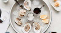 """We check in with the """"It Girl"""" of Portland happy hours: the oyster. By Diane Hudson<!-- AddThis Sharing Buttons below --><!-- AddThis Sharing Buttons below -->                 <div class=""""addthis_toolbox addthis_default_style addthis_"""" addthis:url='http://www.portlandmonthly.com/portmag/2019/06/oysters-a-love-story/' addthis:title='Oysters: A Love Story' >                     <a class=""""addthis_button_preferred_1""""></a>                     <a class=""""addthis_button_preferred_2""""></a>                     <a class=""""addthis_button_preferred_3""""></a>                     <a class=""""addthis_button_preferred_4""""></a>                     <a class=""""addthis_button_compact""""></a>                     <a class=""""addthis_counter addthis_bubble_style""""></a>                 </div>"""