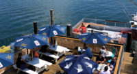 """Soak up every ounce of summer (and cocktails) on these waterfront decks. By Olivia Gunn Kotsishevskaya<!-- AddThis Sharing Buttons below --><!-- AddThis Sharing Buttons below -->                 <div class=""""addthis_toolbox addthis_default_style addthis_"""" addthis:url='http://www.portlandmonthly.com/portmag/2019/07/under-the-sun-over-the-sea/' addthis:title='Under the Sun, Over the Sea' >                     <a class=""""addthis_button_preferred_1""""></a>                     <a class=""""addthis_button_preferred_2""""></a>                     <a class=""""addthis_button_preferred_3""""></a>                     <a class=""""addthis_button_preferred_4""""></a>                     <a class=""""addthis_button_compact""""></a>                     <a class=""""addthis_counter addthis_bubble_style""""></a>                 </div>"""